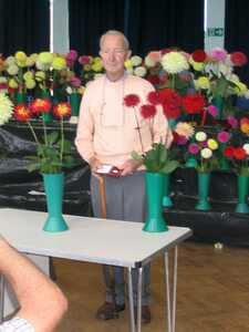Tom McLelland with Weston Spanish Dancer and Weston Pirate Dahlias